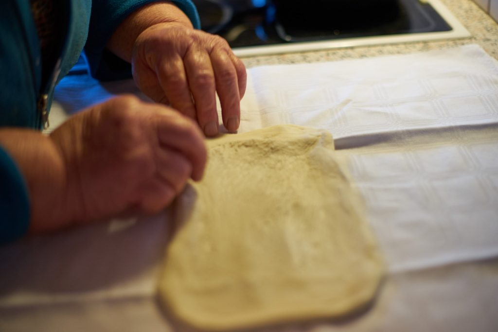 Pulling apart of the Strudel dough.