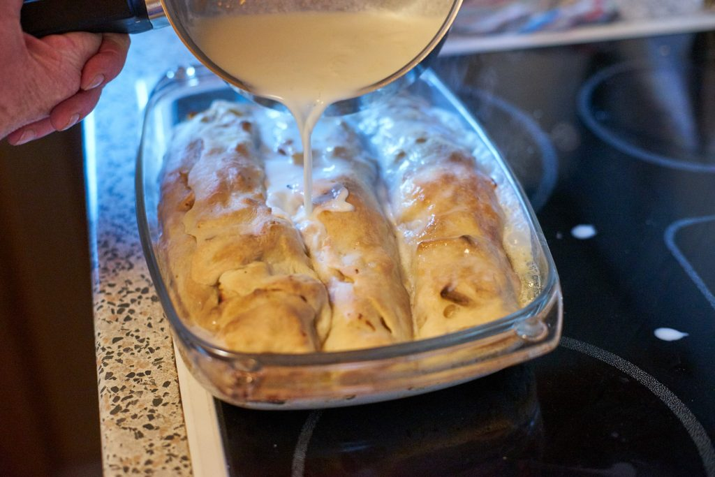 Milk is poured over the strudel.